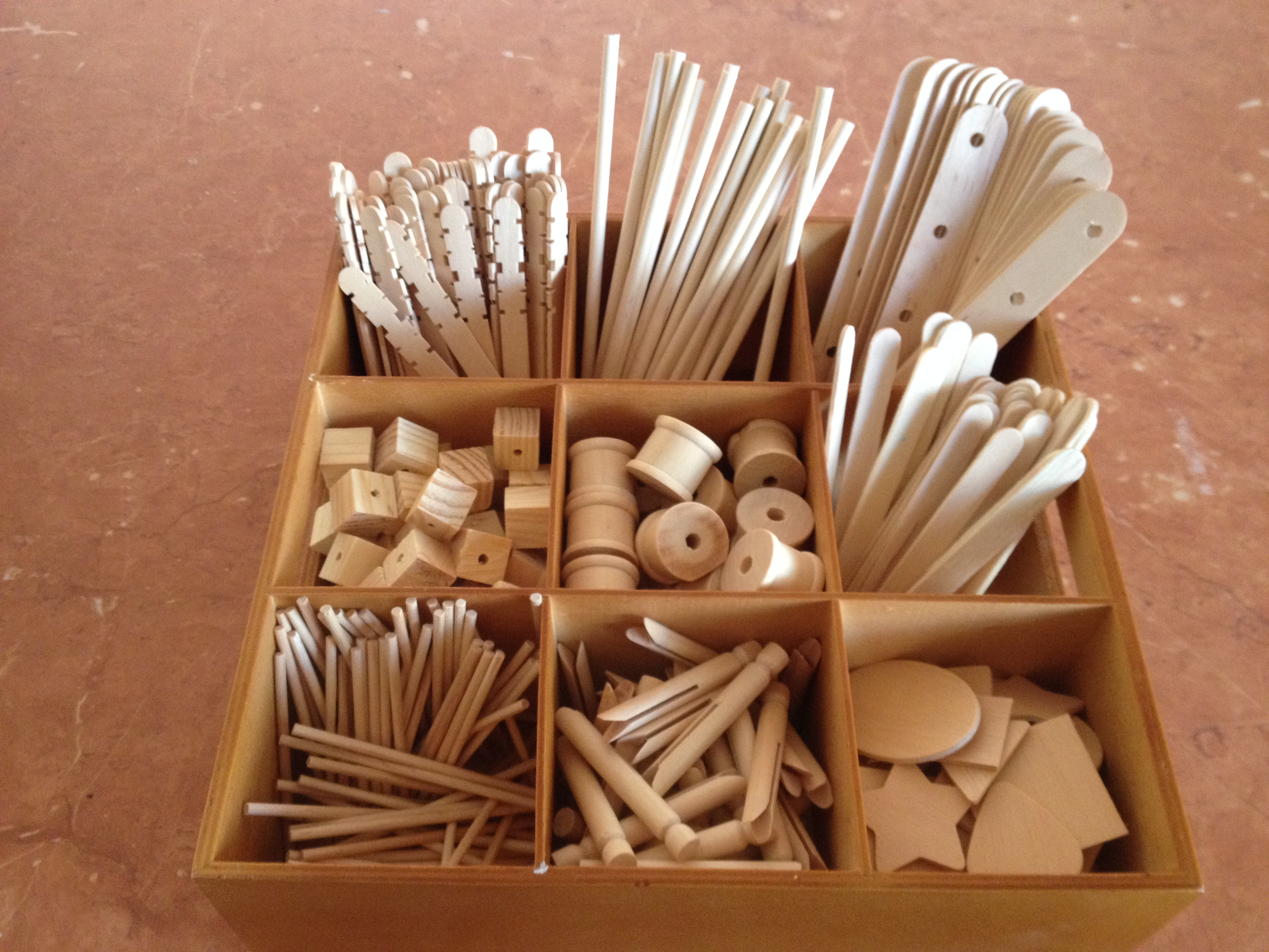 Items In This Tray Include Wooden Shapes Spools Dolly Pegs Blocks Construction Sticks And Other Types Of Such As Ice Cream