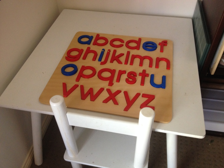 child sized table and alphabet puzzle