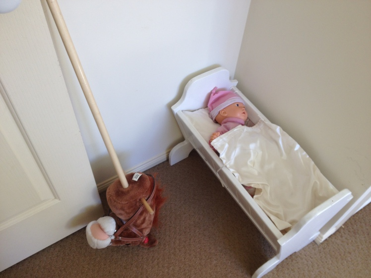 doll and bed and hobby horse