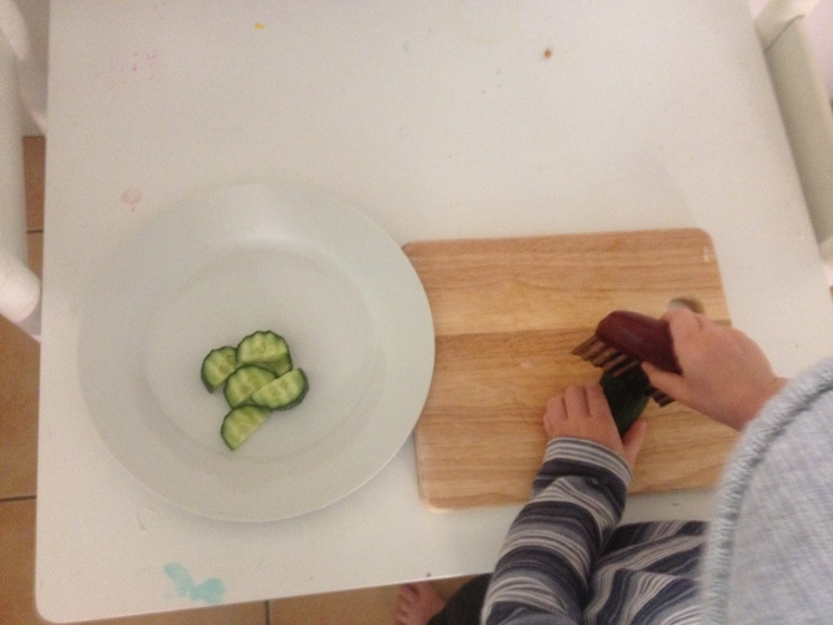 2 year old cucumner chopping.JPG