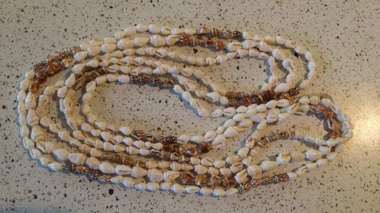 shell necklace- a gift for each of us on arrival at an island
