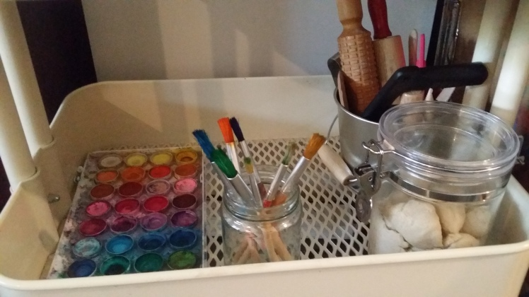 paints and modelling tools art shelf