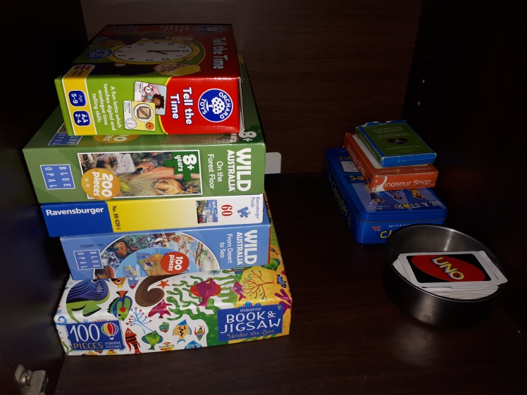 Every Day Begins New- Games and puzzles storage shelf