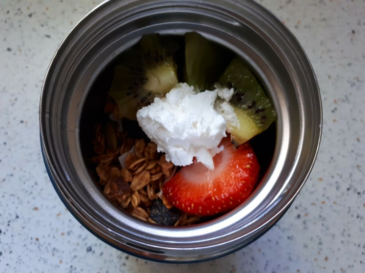 plant-based thermos food- muesli, fruit and coconut yoghurt