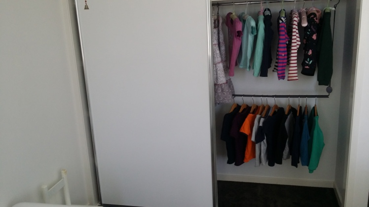 children's Montessori style wardrobe at 3 and 5 years of age