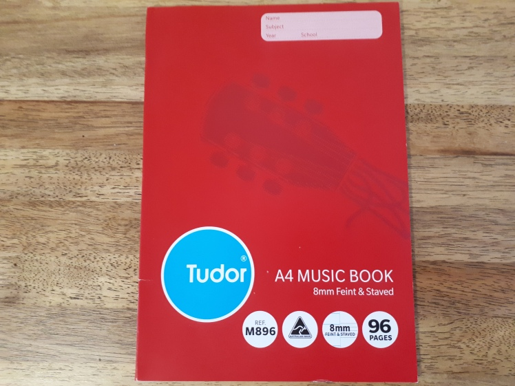 Music book for home sheet writing practice.jpg
