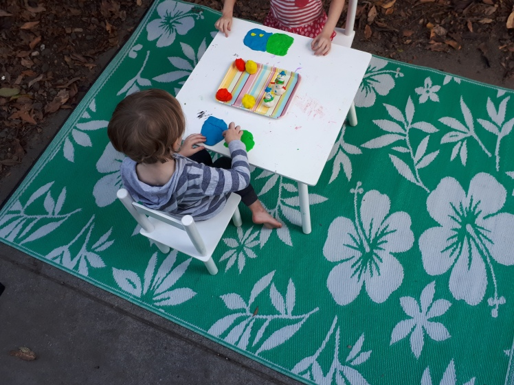 Outdoors colourful playdough play.jpg