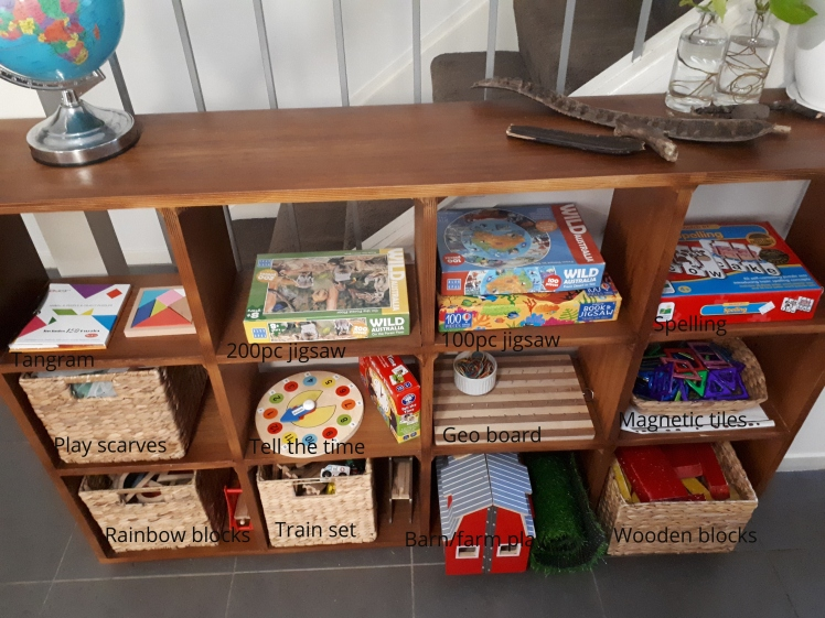 Montessori at home shelf-for a 6 and 4 year old.jpg