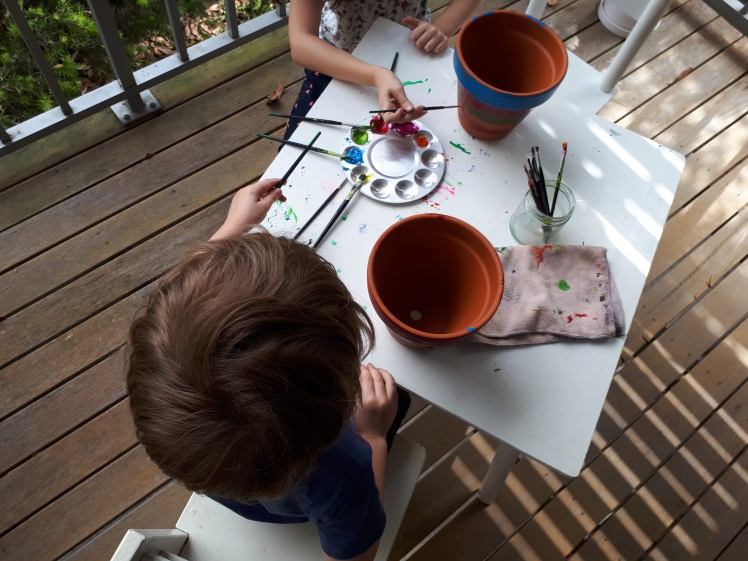 Prepping Christmas presents- painting pots