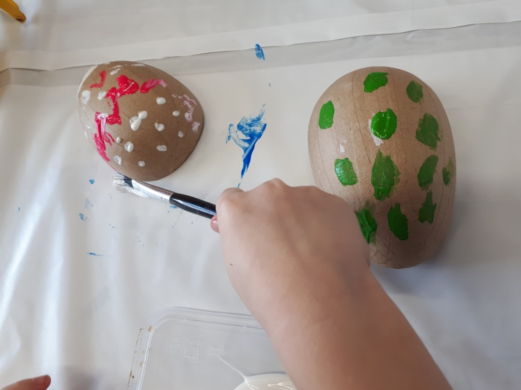 Easter celebrations- painting cardboard eggs.jpg