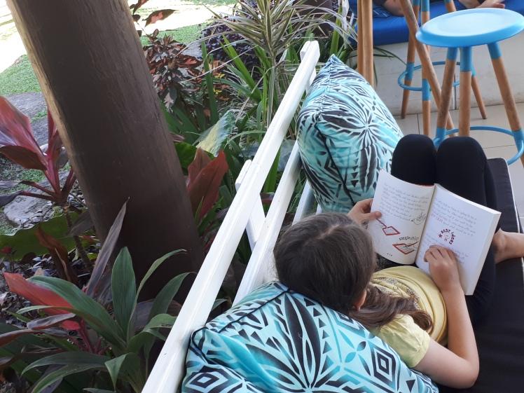 Miss 7 reading in Fiji.jpg