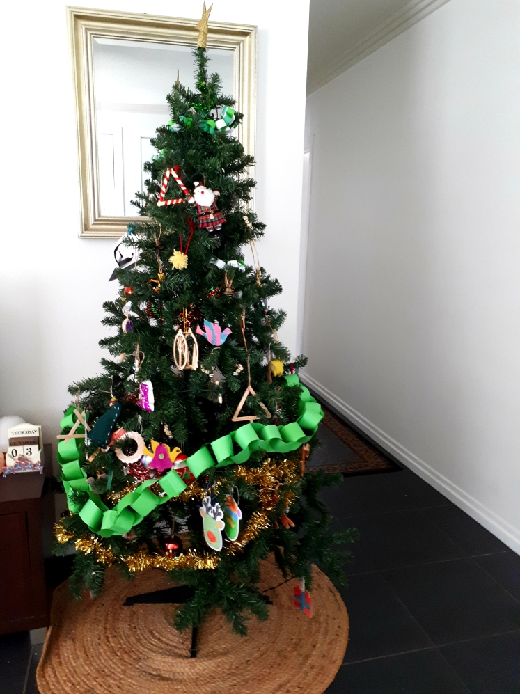 Child decorated Christmas tree